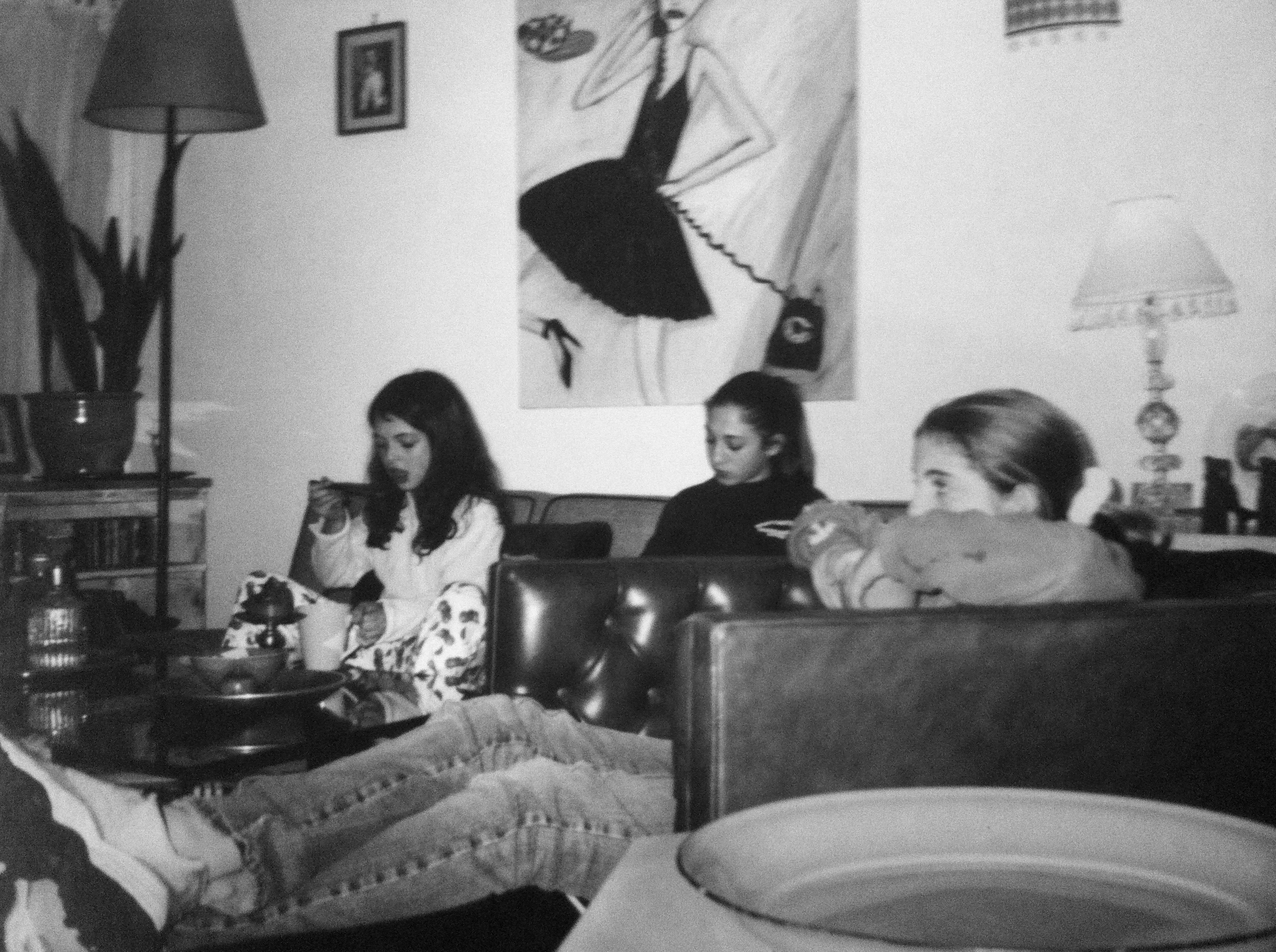 All three girls eating in the living room of Venice house