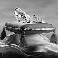 glass slipper on pillow cushion with tassels