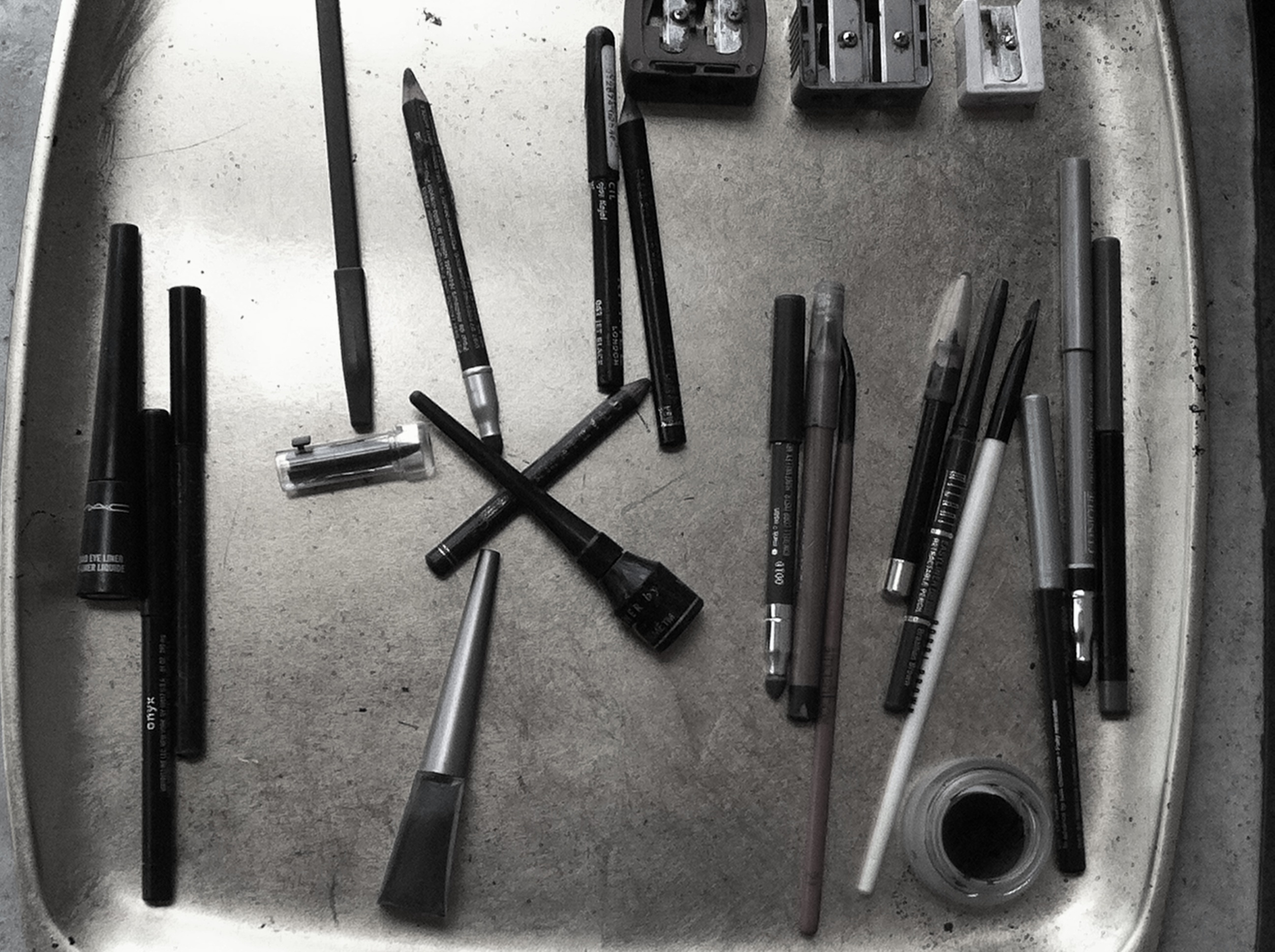 Jill's collection of black eyeliners including pencils, creams, gels, and liquids