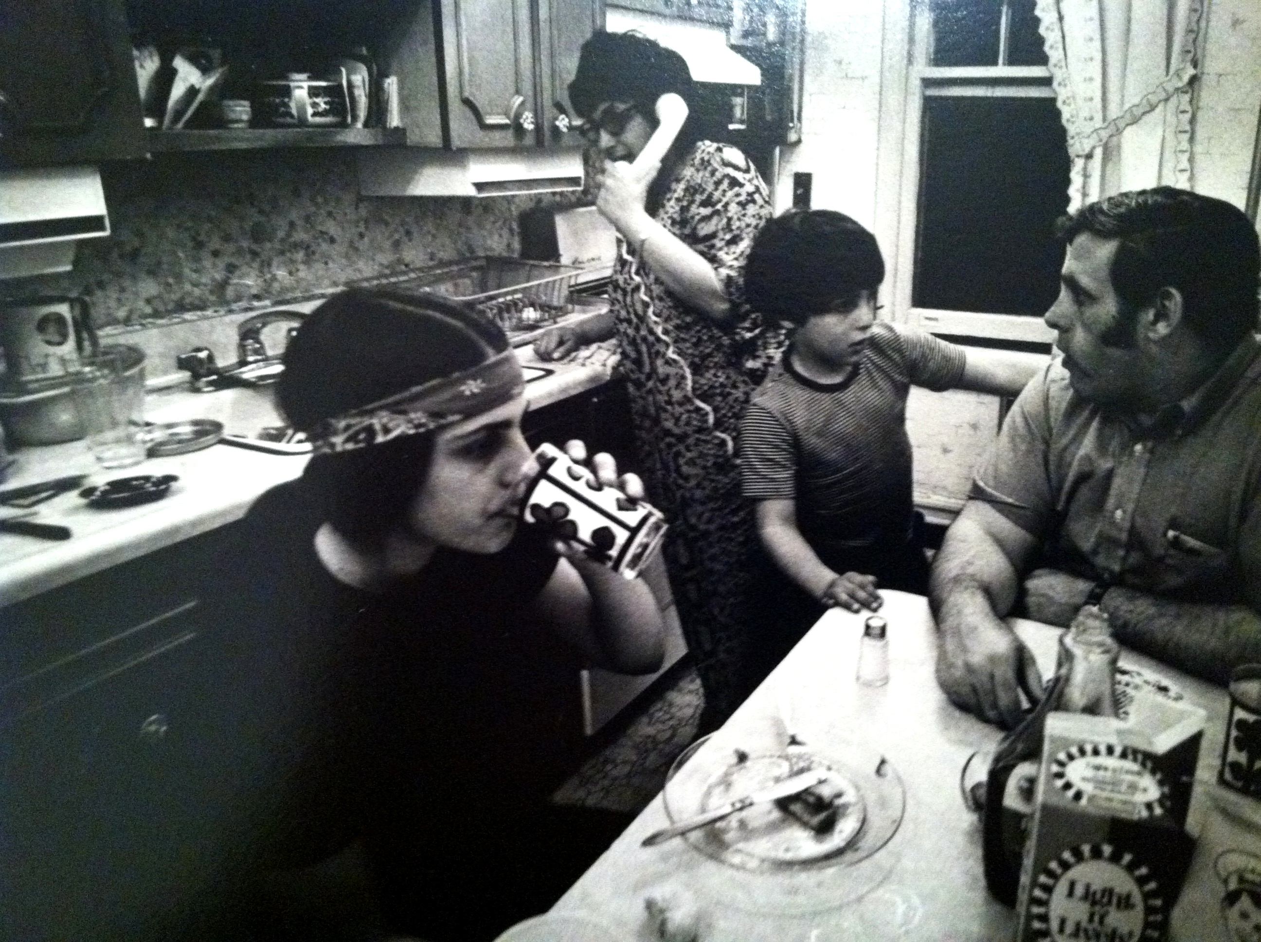 Mom, Dad, my brother and me eating in the kitchen