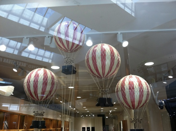 4 red and white striped balloons