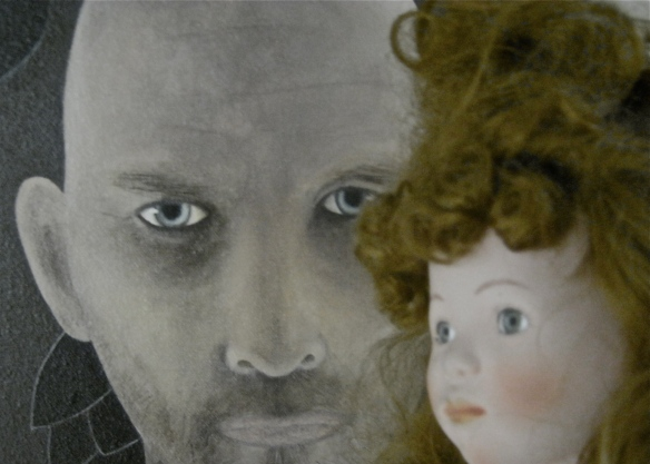 doll and painted portrait of a man