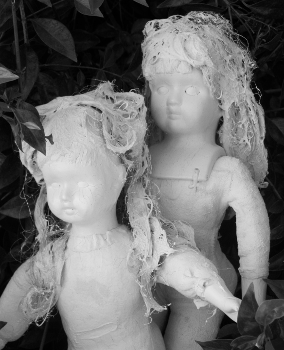 2 painted white dolls