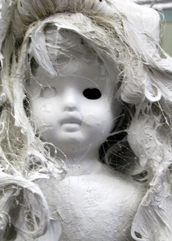 white painted doll with one eye missing