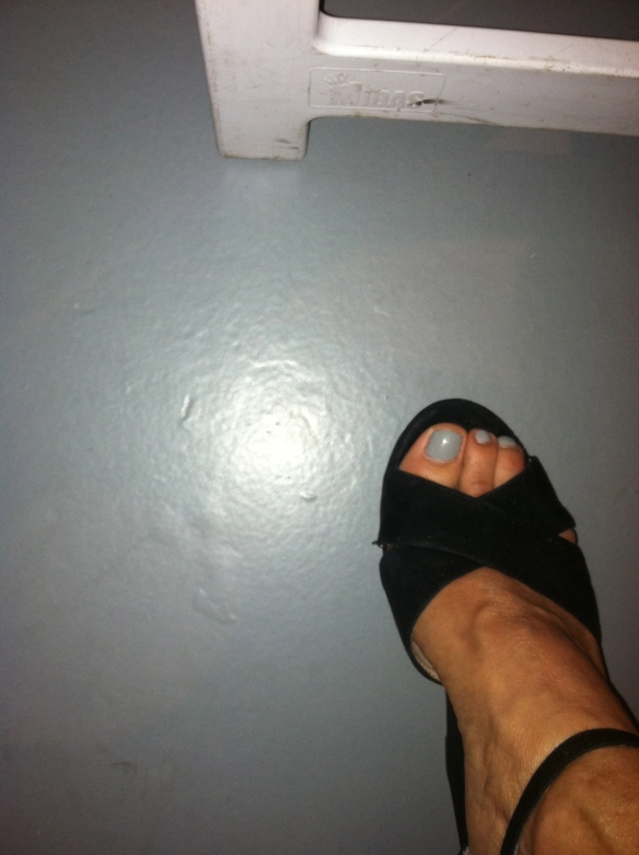 Jill's foot in a black suede open toed shoe