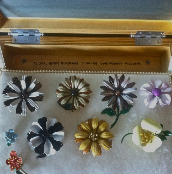 Hand crafted wooden jewelry box with Jill Slaughter's 1960's metal flower pin collection