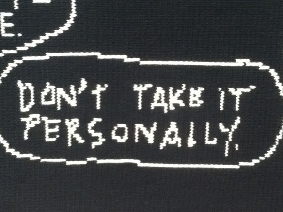 "white letters on black background saying ""Don't Take It Personally"""