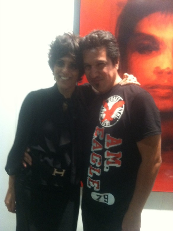 Jill with her arm around painter Josafat Miranda