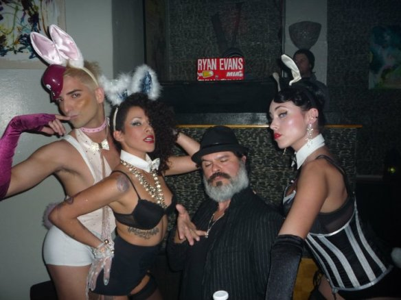 Sexton Garcia surrounded by costumed man and two women